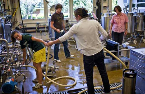 Dave Getzschman photographs students in the midst of making beer.