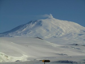 Mt Erebus, the most active volcano in Antarctica, with its signature cloud blowing from the top of the cone. Photo: David Walton.