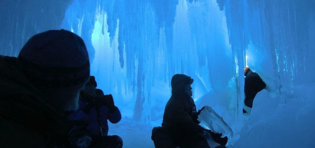 Students in an ice cave on the Erbus Ice Tongue