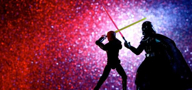 Luke Skywalker figure battling Darth Vader figure