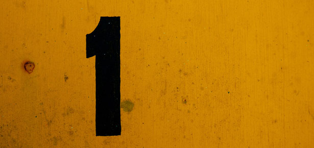 Black number 1 on yellow background. Photo: Sarah Murray via Creative Commons.