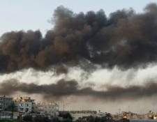 Smoke from buildings damaged in Gaza Strip, 2008. Photo: Amir Farshad Ebrahimi via Creative Commons.