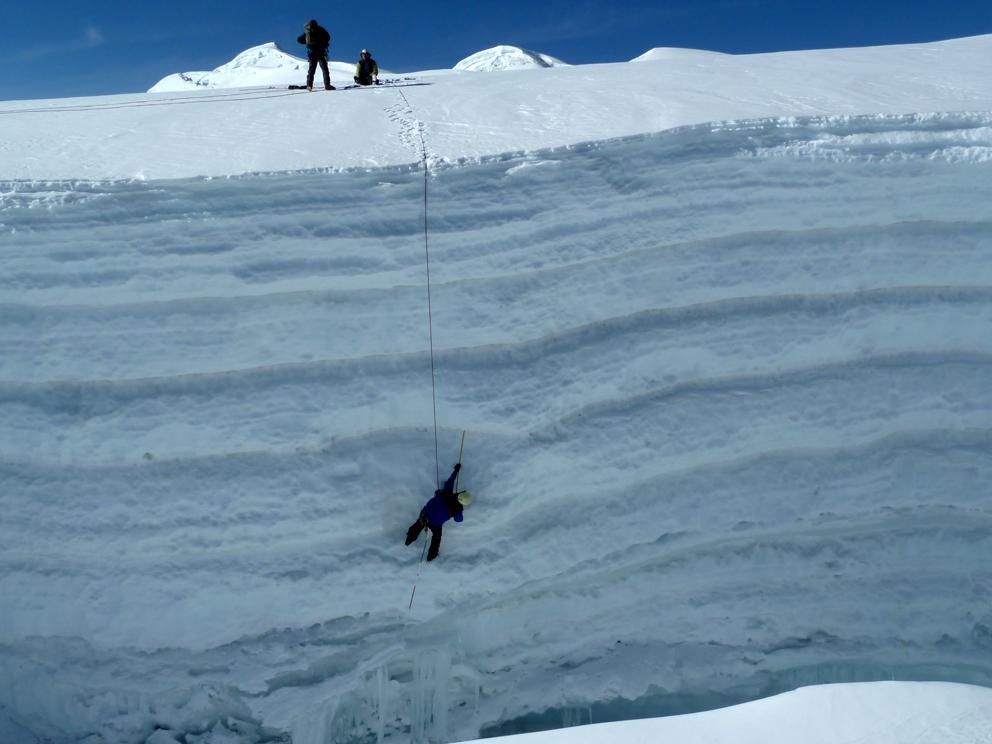 Measurement of snow and firn layers on Suyuparina glacier, southern Peru. Photo: Christian Huggel.