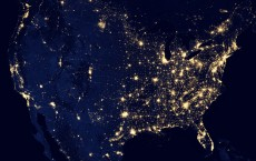 """NASA image acquired April 18 - October 23, 2012  This image of the United States of America at night is a composite assembled from data acquired by the Suomi NPP satellite in April and October 2012. The image was made possible by the new satellite's """"day-night band"""" of the Visible Infrared Imaging Radiometer Suite (VIIRS), which detects light in a range of wavelengths from green to near-infrared and uses filtering techniques to observe dim signals such as city lights, gas flares, auroras, wildfires, and reflected moonlight.  """"Nighttime light is the most interesting data that I've had a chance to work with,"""" says Chris Elvidge, who leads the Earth Observation Group at NOAA's National Geophysical Data Center. """"I'm always amazed at what city light images show us about human activity."""" His research group has been approached by scientists seeking to model the distribution of carbon dioxide emissions from fossil fuels and to monitor the activity of commercial fishing fleets. Biologists have examined how urban growth has fragmented animal habitat. Elvidge even learned once of a study of dictatorships in various parts of the world and how nighttime lights had a tendency to expand in the dictator's hometown or province.  Named for satellite meteorology pioneer Verner Suomi, NPP flies over any given point on Earth's surface twice each day at roughly 1:30 a.m. and p.m. The polar-orbiting satellite flies 824 kilometers (512 miles) above the surface, sending its data once per orbit to a ground station in Svalbard, Norway, and continuously to local direct broadcast users distributed around the world. Suomi NPP is managed by NASA with operational support from NOAA and its Joint Polar Satellite System, which manages the satellite's ground system.  NASA Earth Observatory image by Robert Simmon, using Suomi NPP VIIRS data provided courtesy of Chris Elvidge (NOAA National Geophysical Data Center). Suomi NPP is the result of a partnership between NASA, NOAA, and t"""