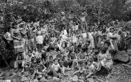 "Villagers in a guerrilla-held territory in Chalatenango, El Salvador, in 1984. They had just finished a meeting of their ""Local Popular Power"" council, a form of participatory democracy that coordinated things like education, healthcare, food production, and security in the region. Photo courtesy of Mike Goldwater."