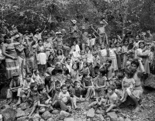 """Villagers in a guerrilla-held territory in Chalatenango, El Salvador, in 1984. They had just finished a meeting of their """"Local Popular Power"""" council, a form of participatory democracy that coordinated things like education, healthcare, food production, and security in the region. Photo courtesy of Mike Goldwater."""