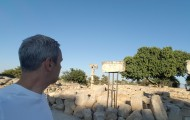 The author looks over the ruins of Ramat Rahel near Jerusalem. He argues it was the site of an ancient Assyrian imperial citadel whose destruction was celebrated in Isaiah 24-27.