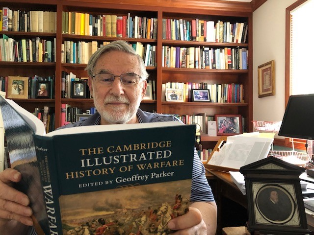 Editor Geoffrey Parker is pictured reading The Cambridge Illustrated History of Warfare