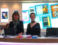 Alison Thomson and Gemma Valpy standing at the Cambridge University Press stand at Frankfurt Book Fair 2013.