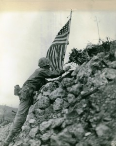US Marines raising the flag atop the ruins of Shuri Castle after the Battle of Okinawa. Image courtesy of Wikimedia Commons