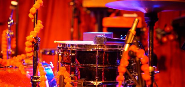 """This photo of drums, cymbal, and microphone connects with areas of the book that discuss the rhythms of music, and their effects on physiological processes, exercise, and therapeutic benefits, as well as social justice concerns of equality, mutual respect, personal dignity, and individual and communal autonomy. Further, at every age we find people """"making music"""" as they tap their foot or drum along with the songs and musical sounds they hear. Thus, the drum is one of the most popular musical instruments -- one that expresses rhythms of life that are universally known and understood, and whose sounds directs us onto pathways where we may discover new opportunities for self-expression and ways of becoming."""